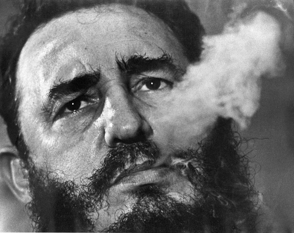 FILE - In this March 1985 file photo, Cuba's leader Fidel Castro exhales cigar smoke during an interview at the presidential palace in ...