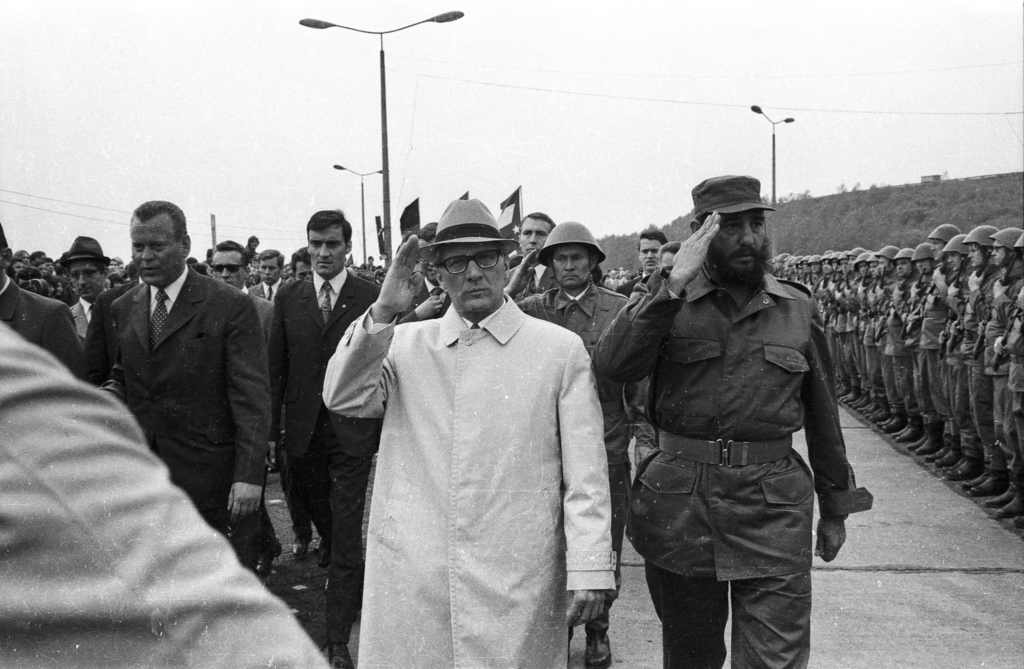 FILE - In this June 1972 file photo, Cuba's leader Fidel Castro, right, reviews troops during his visit to Leuna, formerly the German D...