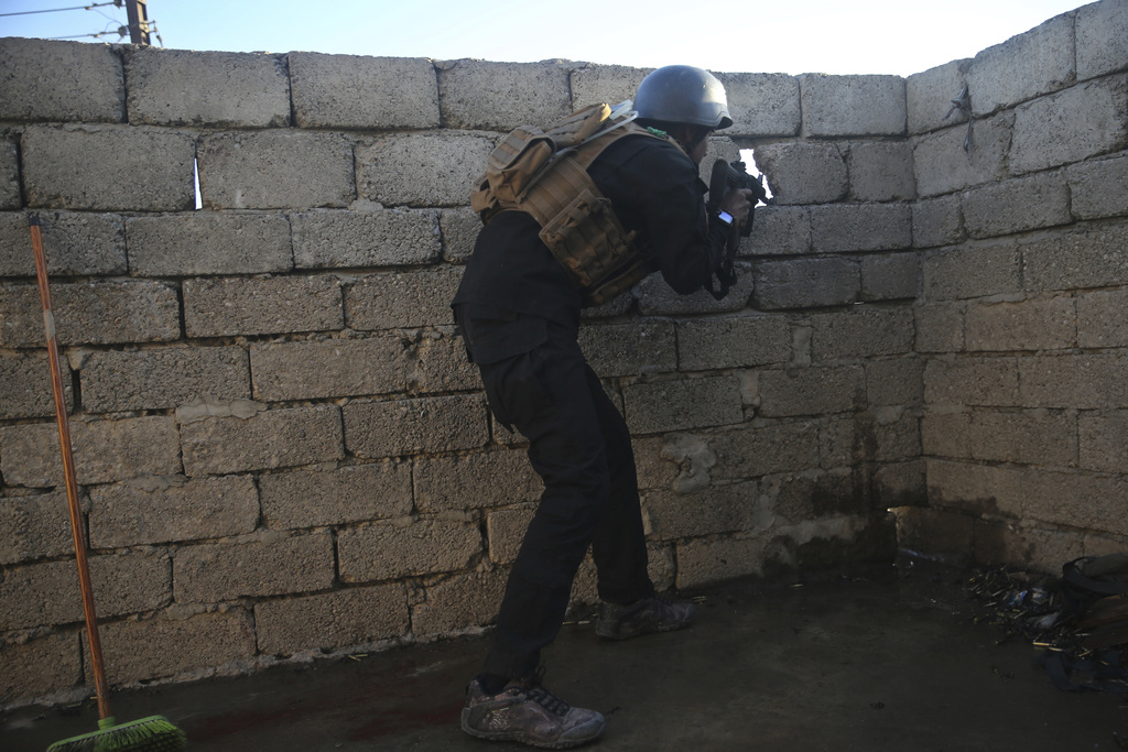 An Iraqi special forces soldier battles against Islamic State militants, in the Bakr front line neighborhood, in Mosul, Iraq, Friday No...