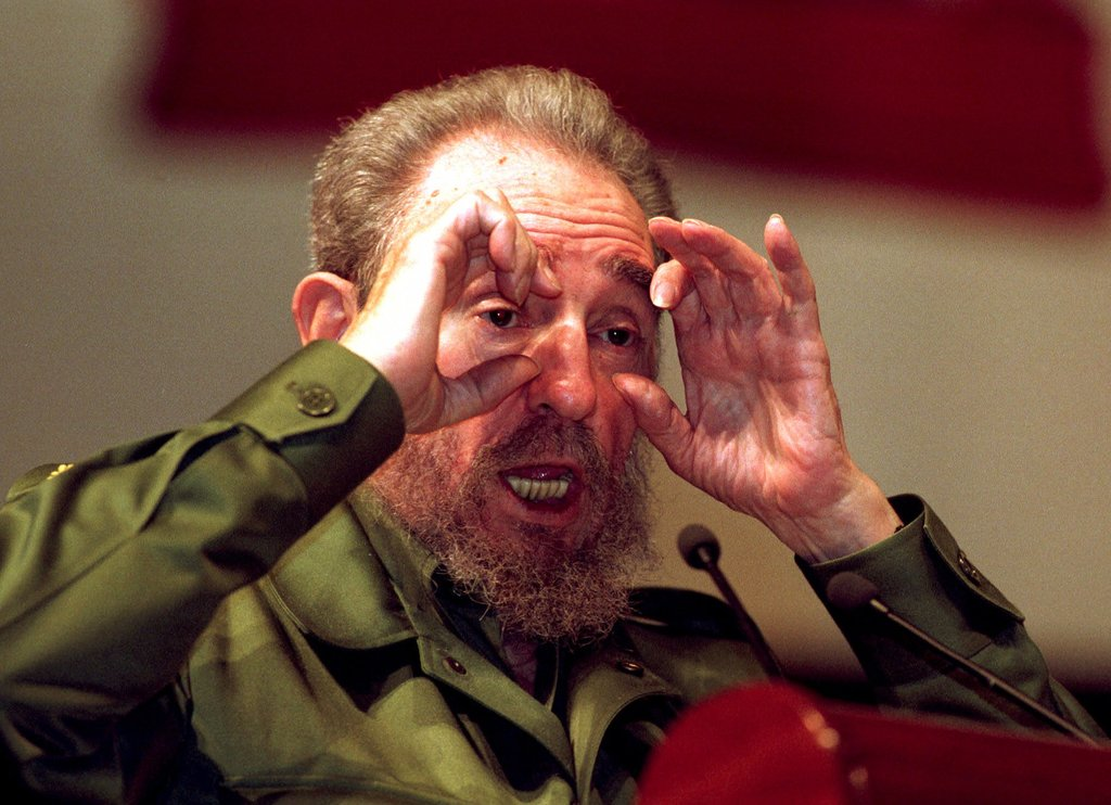 FILE - In this Aug.18, 1999 file photo, Cuba's leader Fidel Castro gestures at a speaking event as he explains that he does not underst...