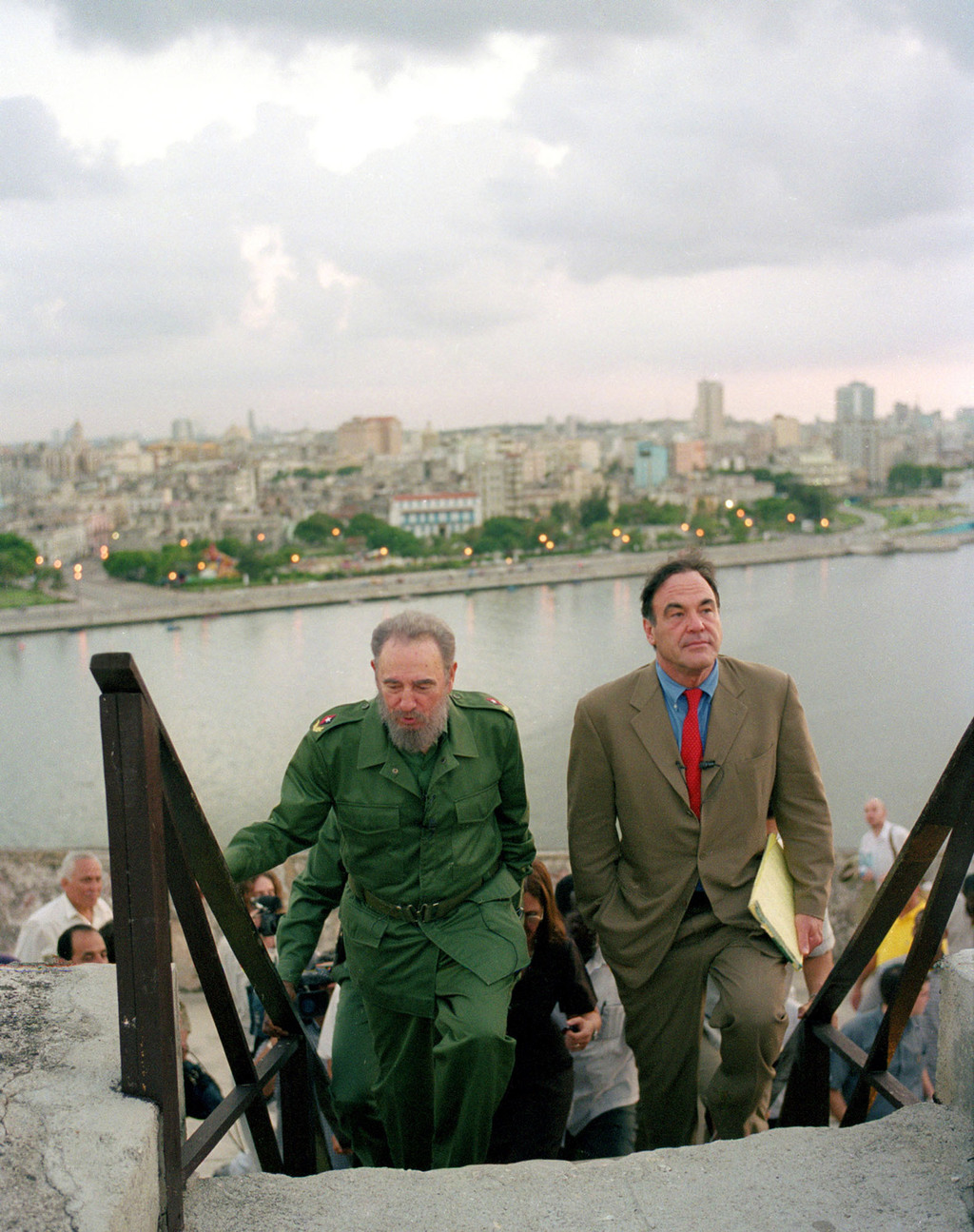 FILE - In this undated file publicity photo released by HBO, Cuba's leader Fidel Castro, left, walks with Oliver Stone during Stone's m...