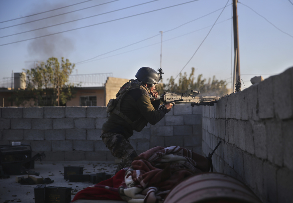 An Iraqi special forces soldier battles against the Islamic State militants from house to house, in the Bakr front line neighborhood, i...