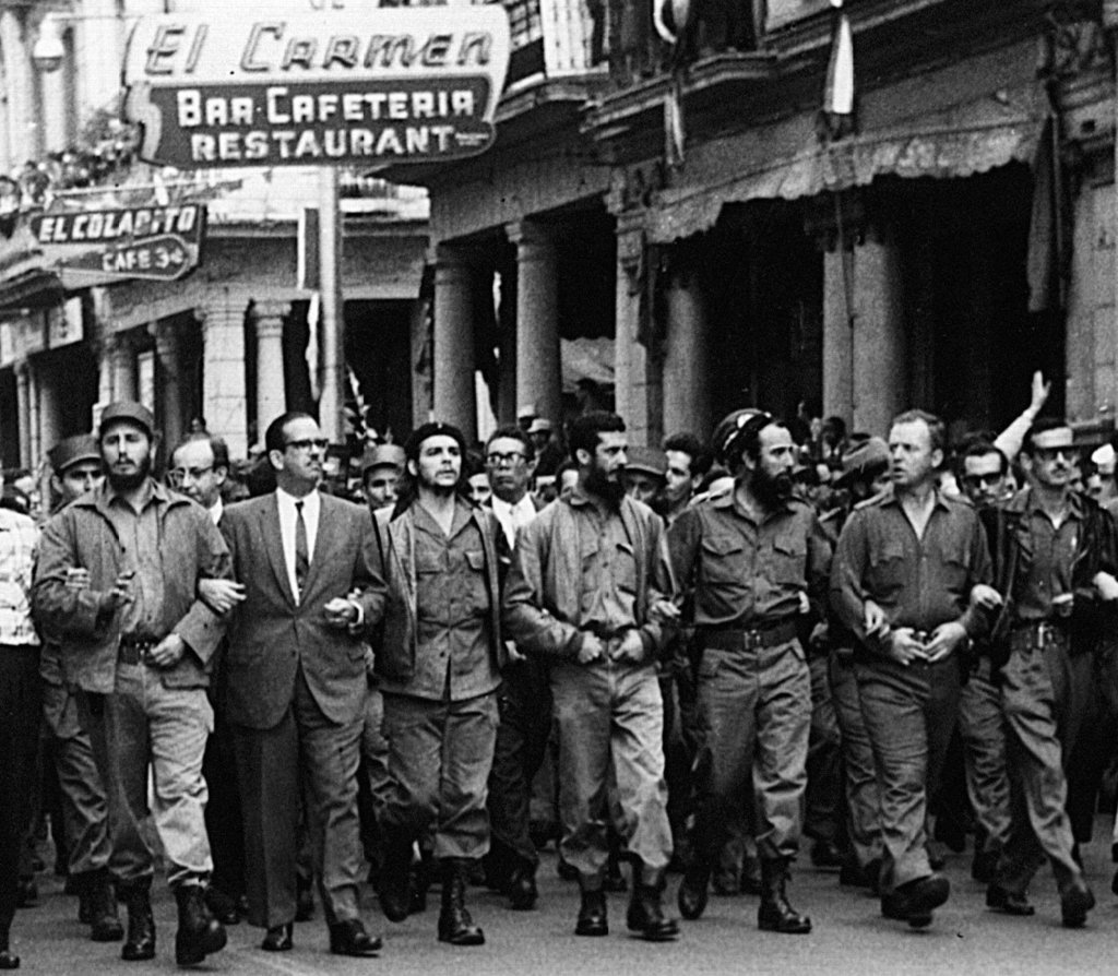 FILE - In this March 5, 1960 file photo, Cuban leaders walk arm-in-arm at the head of the funeral procession for the victims of the La ...