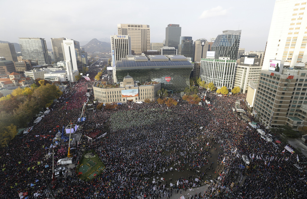 FILE - In this Saturday, Nov. 12, 2016, file photo, protesters stage a rally calling for South Korean President Park Geun-hye to step d...