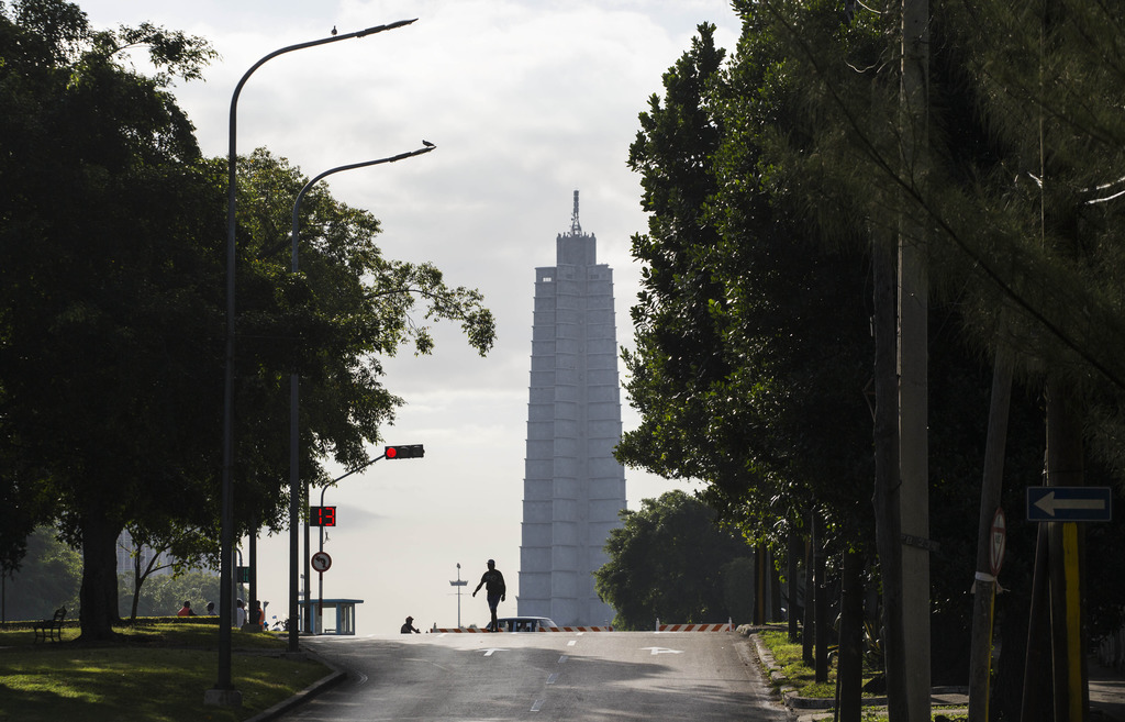 A man crosses Paseo Avenue, which leads to Revolution Square that's closed to traffic in Havana, Cuba, Saturday, Nov. 26, 2016, the day...