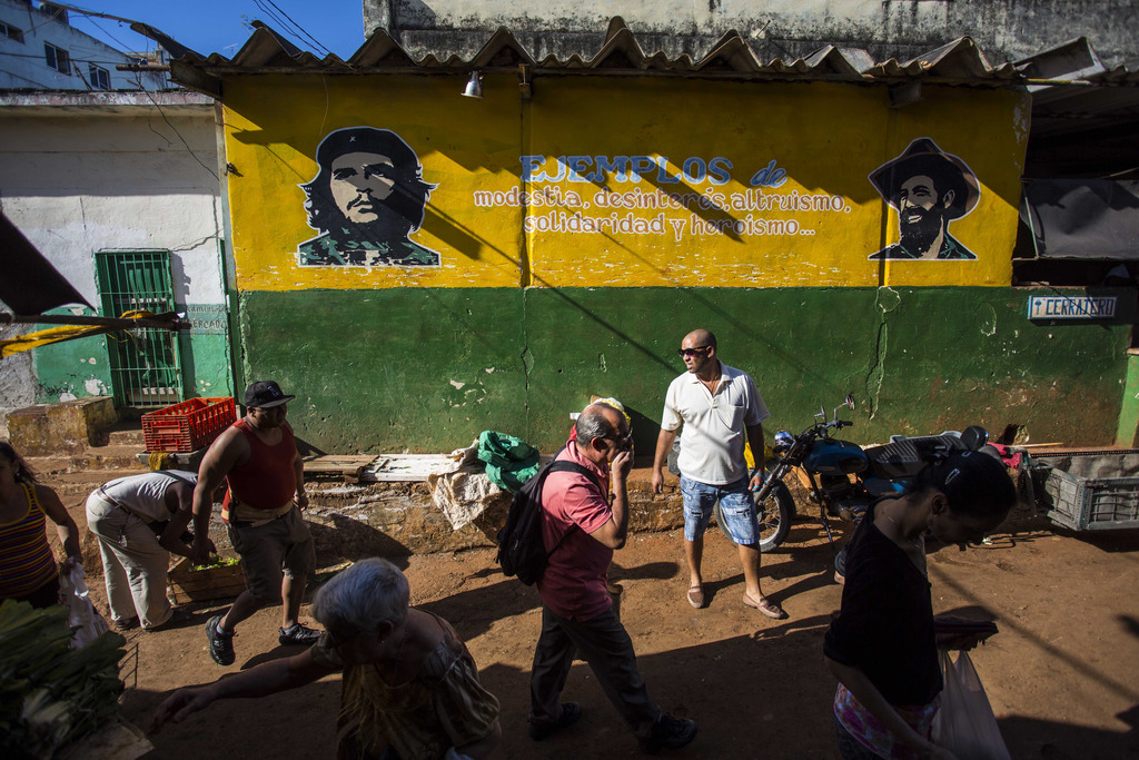 People do their shopping at a food market in Havana, Cuba, Saturday, Nov. 26, 2016, the day after Fidel Castro's death. Cuba will obser...