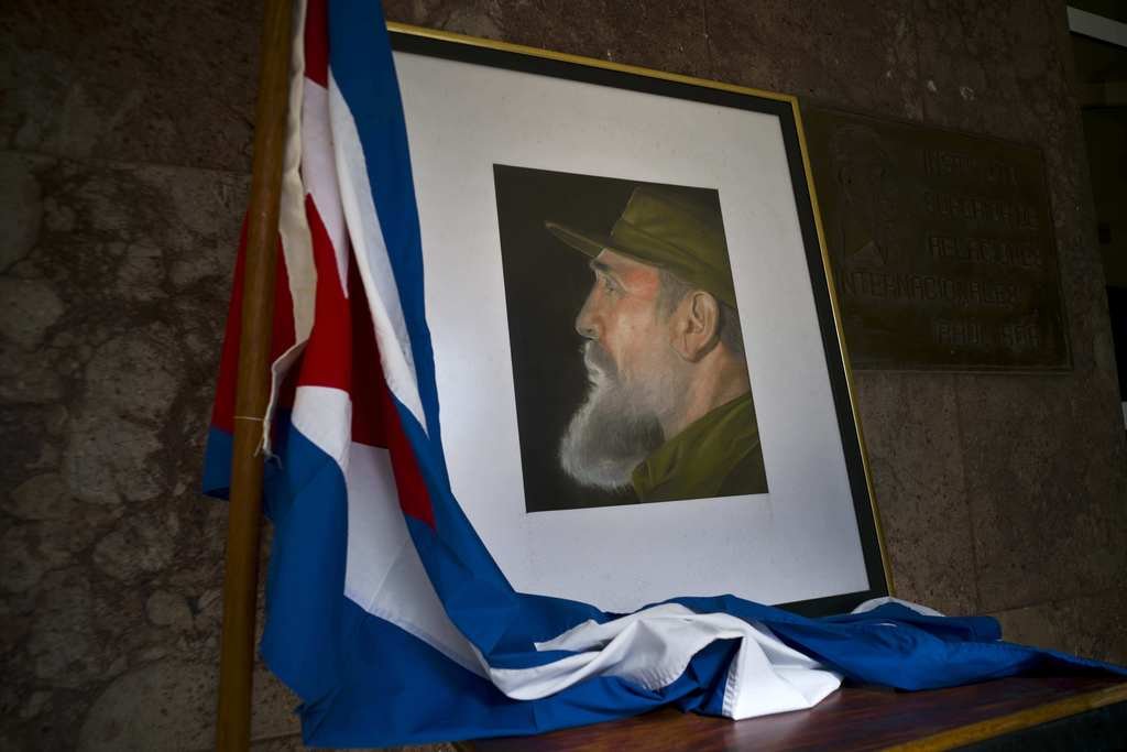 An image of Fidel Castro and a Cuban flag are displayed in honor of Castro the day after he died, inside the foreign ministry in Havana...