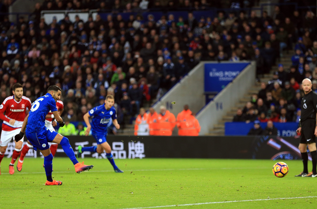 Leicester City's Riyad Mahrez scores his side's first goal of the game from the penalty spot during their English Premier League soccer...
