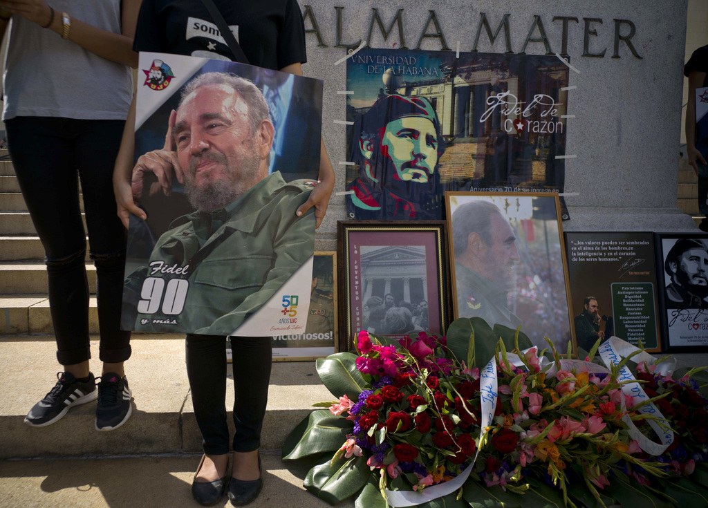 People with images of Fidel Castro gather one day after his death in Havana, Cuba, Saturday, Nov. 26, 2016. Cuba will observe nine days...