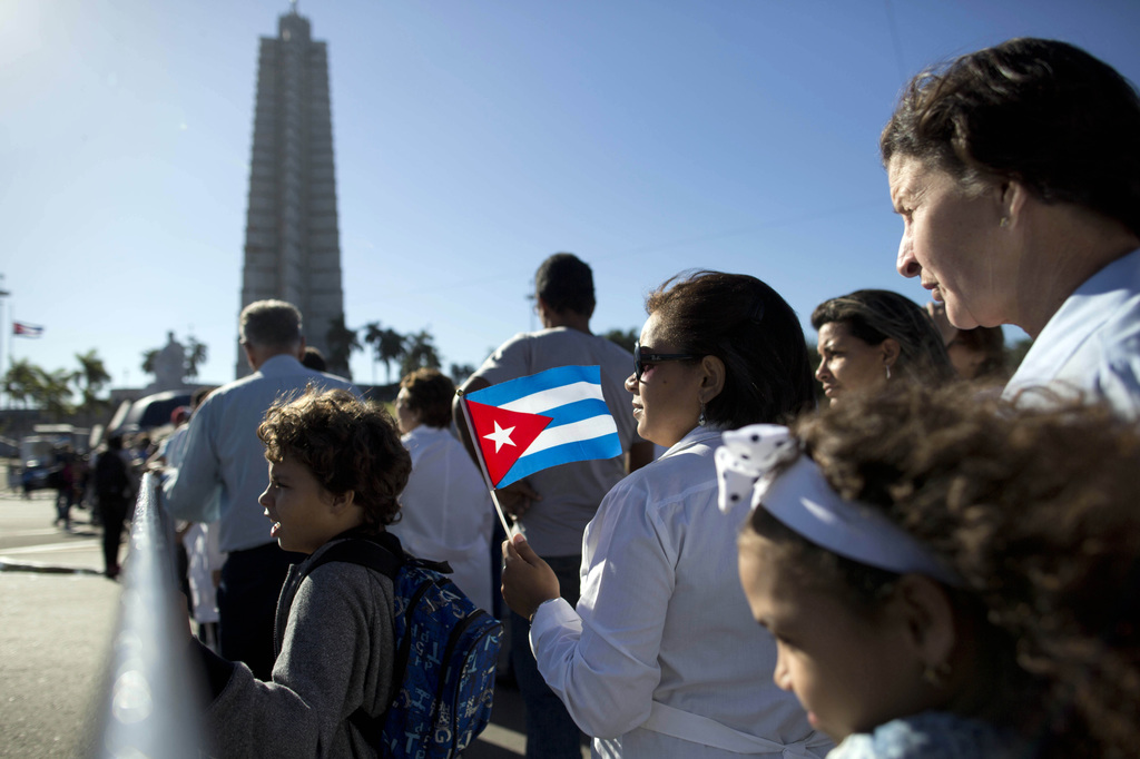 Mourners line up at Revolution Plaza, the site of two days of tributes to the late Fidel Castro, in Havana, Cuba, Monday, Nov. 28, 2016...