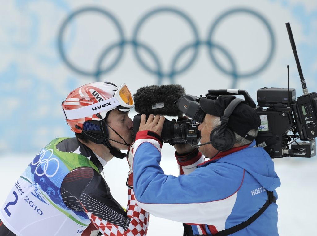 FILE - In this Feb. 27, 2010 file photo Croatia's Ivica Kostelic kisses a TV camera as he reacts after finishing the second run of the ...