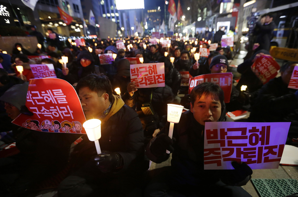 Protesters shout slogans during a rally calling for South Korean President Park Geun-hye to step down in Seoul, South Korea, Tuesday, N...