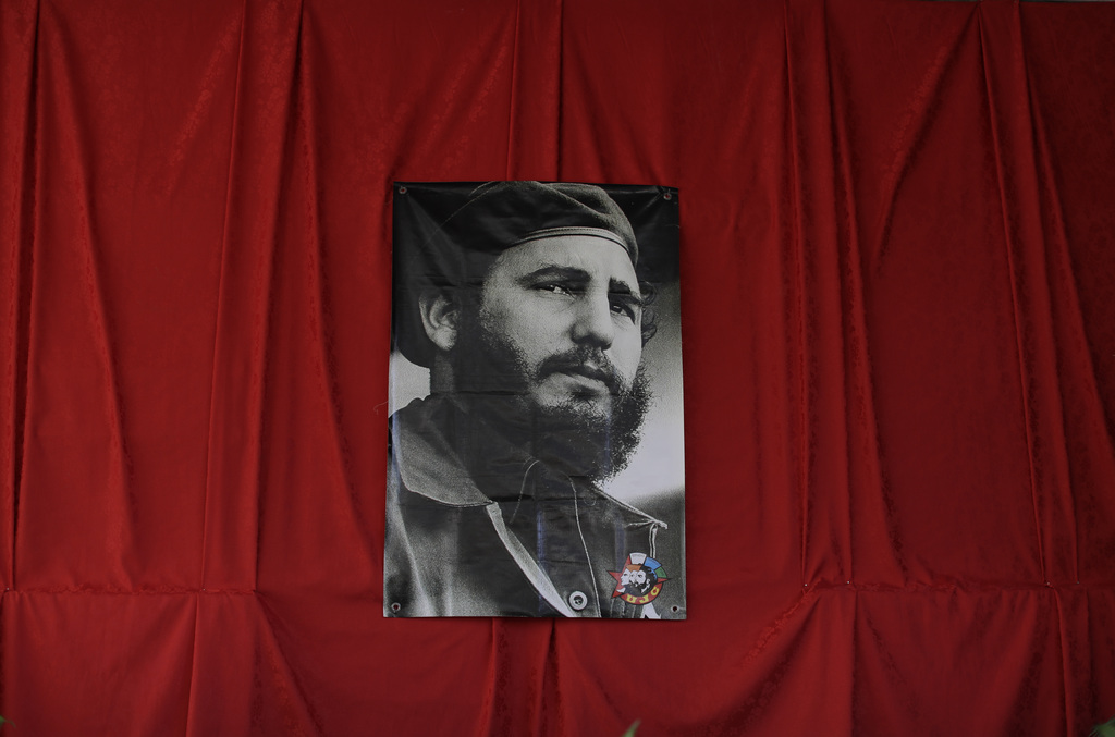A photograph of the late Fidel Castro hangs at a memorial in his honor in Guanabacoa on the outskirts of Havana, Cuba, Monday, Nov. 28,...