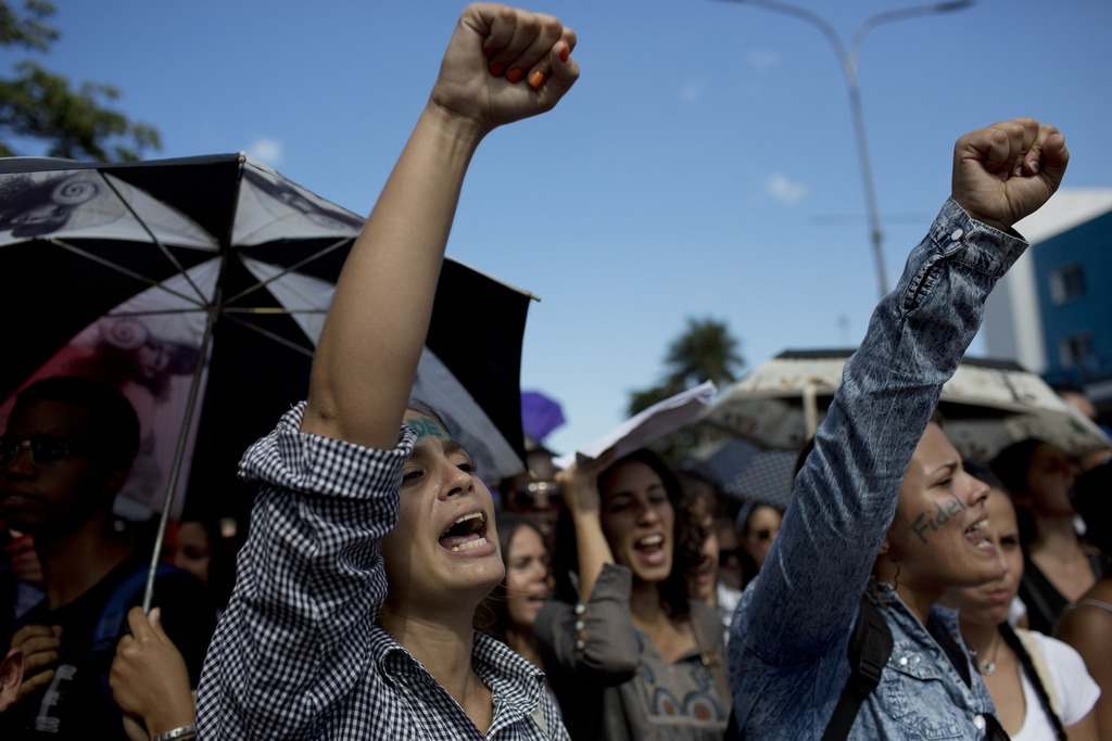 University students chants slogans in honor of the late Fidel Castro in Havana, Cuba, Monday, Nov. 28, 2016. Tribute sites are set up i...