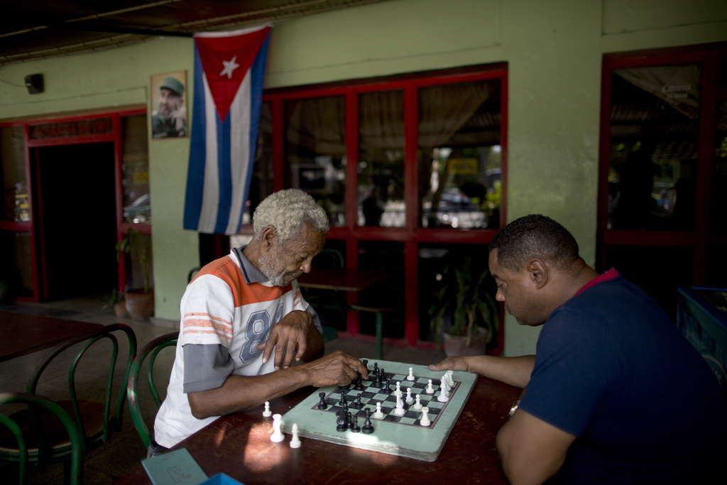 Men play chess at a bar near Revolution Plaza, the site of two days of tributes to the late Fidel Castro, in Havana, Cuba, Monday, Nov....