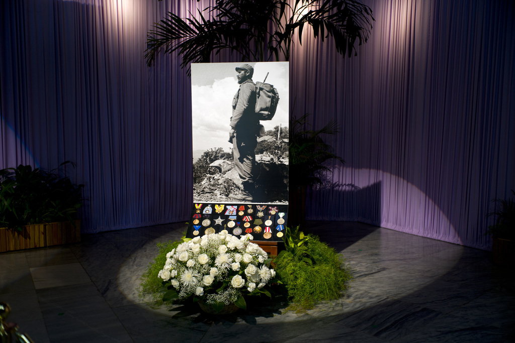 Roses and medals serve as a base for a portrait of the late Fidel Castro at Revolution Plaza, the site of two days of tributes to the l...