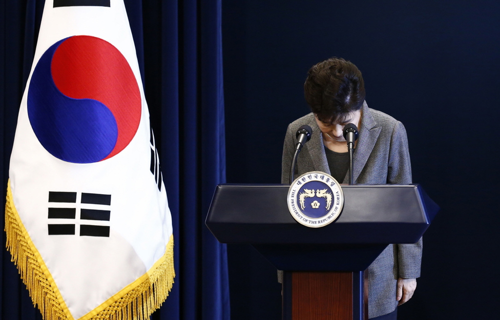 South Korean President Park Geun-hye bows during her address to the nation at the presidential Blue House in Seoul, Tuesday, Nov. 29, 2...
