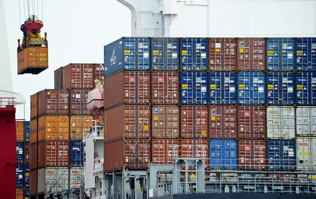 FILE- In this Aug. 5, 2010, file photo, a container is loaded onto a cargo ship at the Tianjin port in China. American consumers and bu...