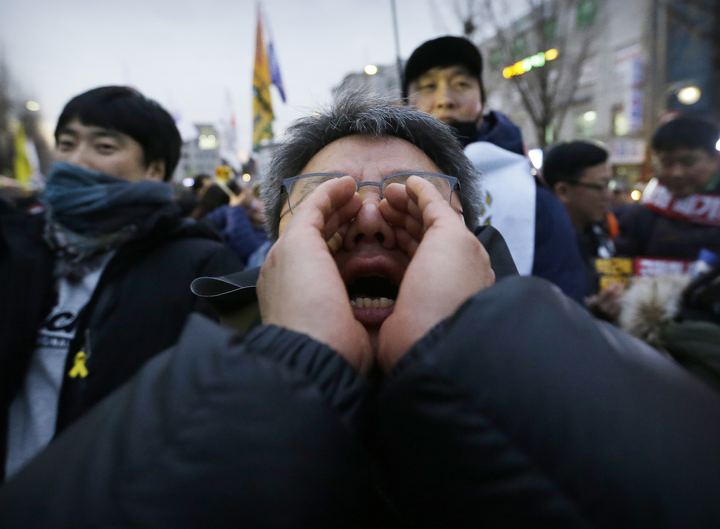 A protester shouts during a rally calling for South Korean President Park Geun-hye to step down in Seoul, South Korea, Wednesday, Nov. ...