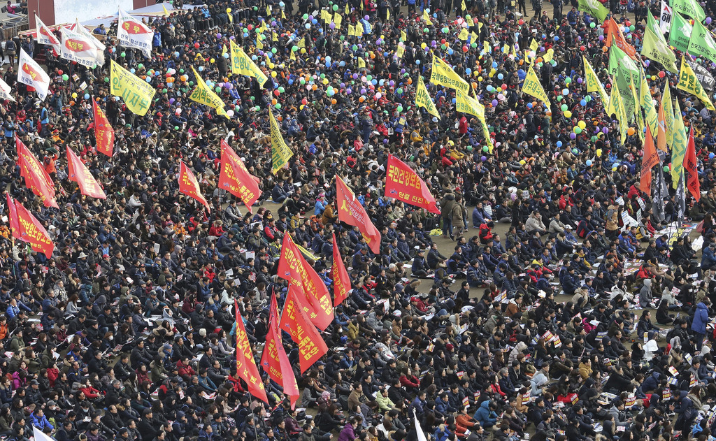 Protesters stage a rally calling for South Korean President Park Geun-hye to step down in Seoul, South Korea, Wednesday, Nov. 30, 2016....
