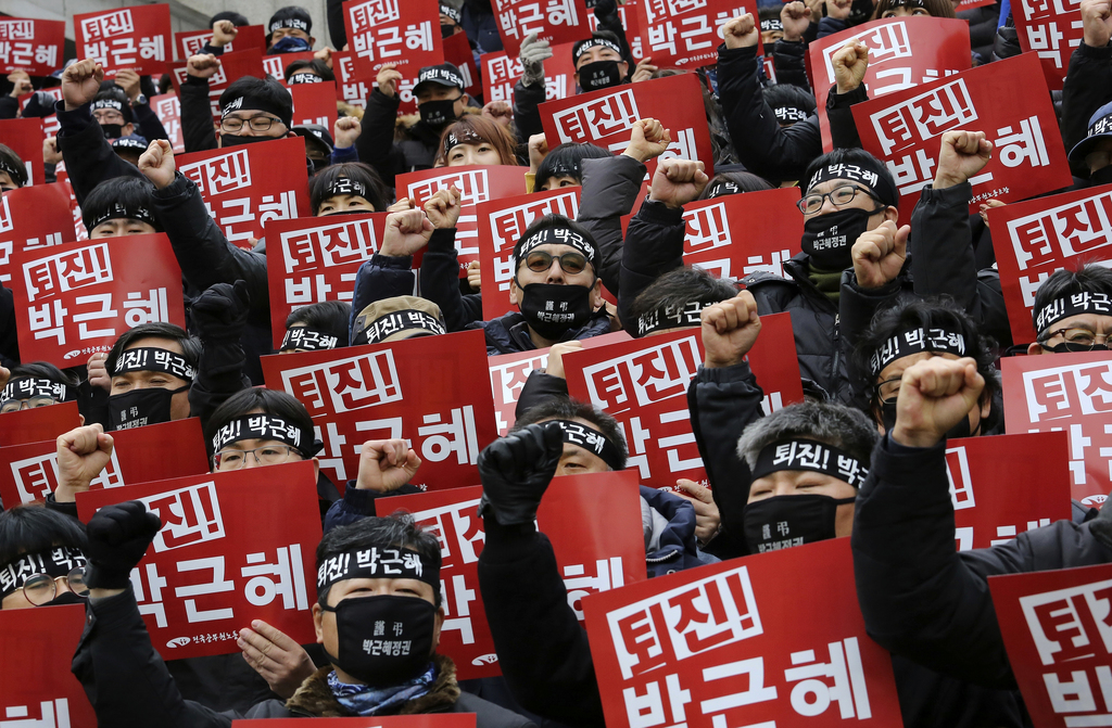Protesters shout slogans during a rally calling for South Korean President Park Geun-hye to step down in Seoul, South Korea, Wednesday,...