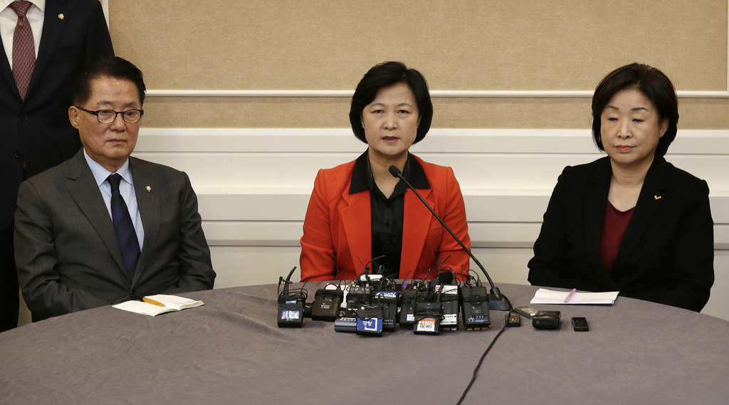 Choo Mi-ae, center, leader of the main opposition Democratic Party, speaks as Park Jie-won, interim leader of the People's Party, and S...