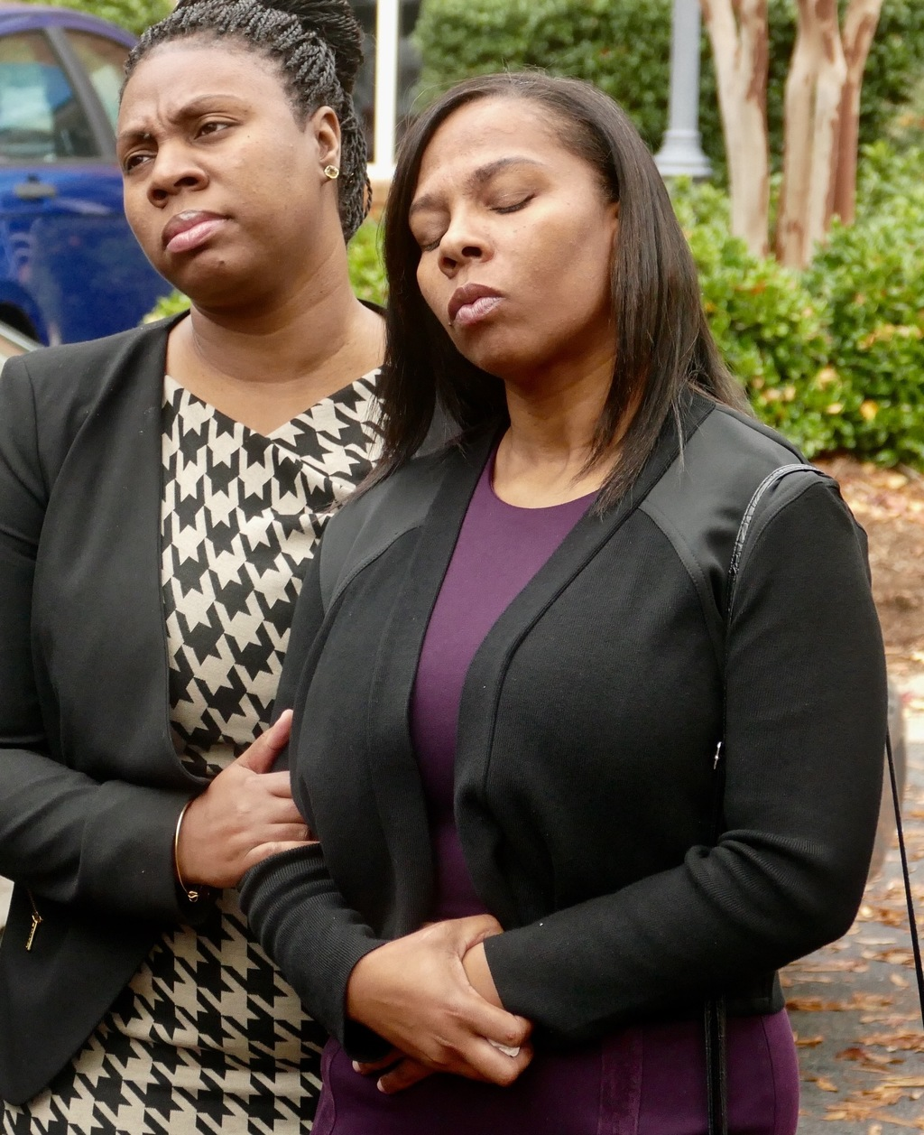 The family of Keith Lamont Scott including his wife Rakeyia Scott, right, attend a news conference after finding out charges would not ...