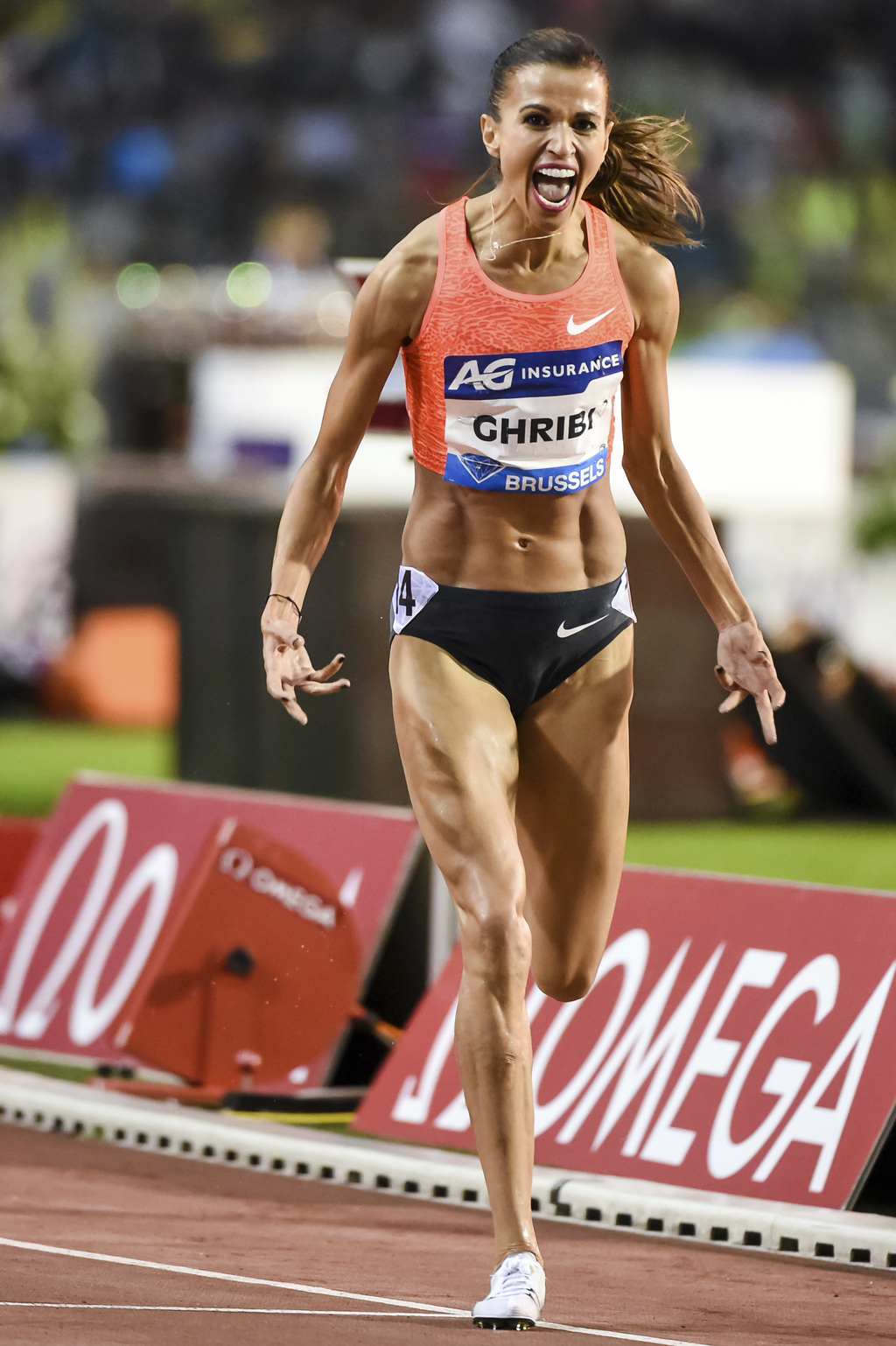 FILE In this Friday, July 17, 2015 file photo, Habiba Ghribi from Tunisia celebrates winning the women's 3000m steeplechase at the Diam...