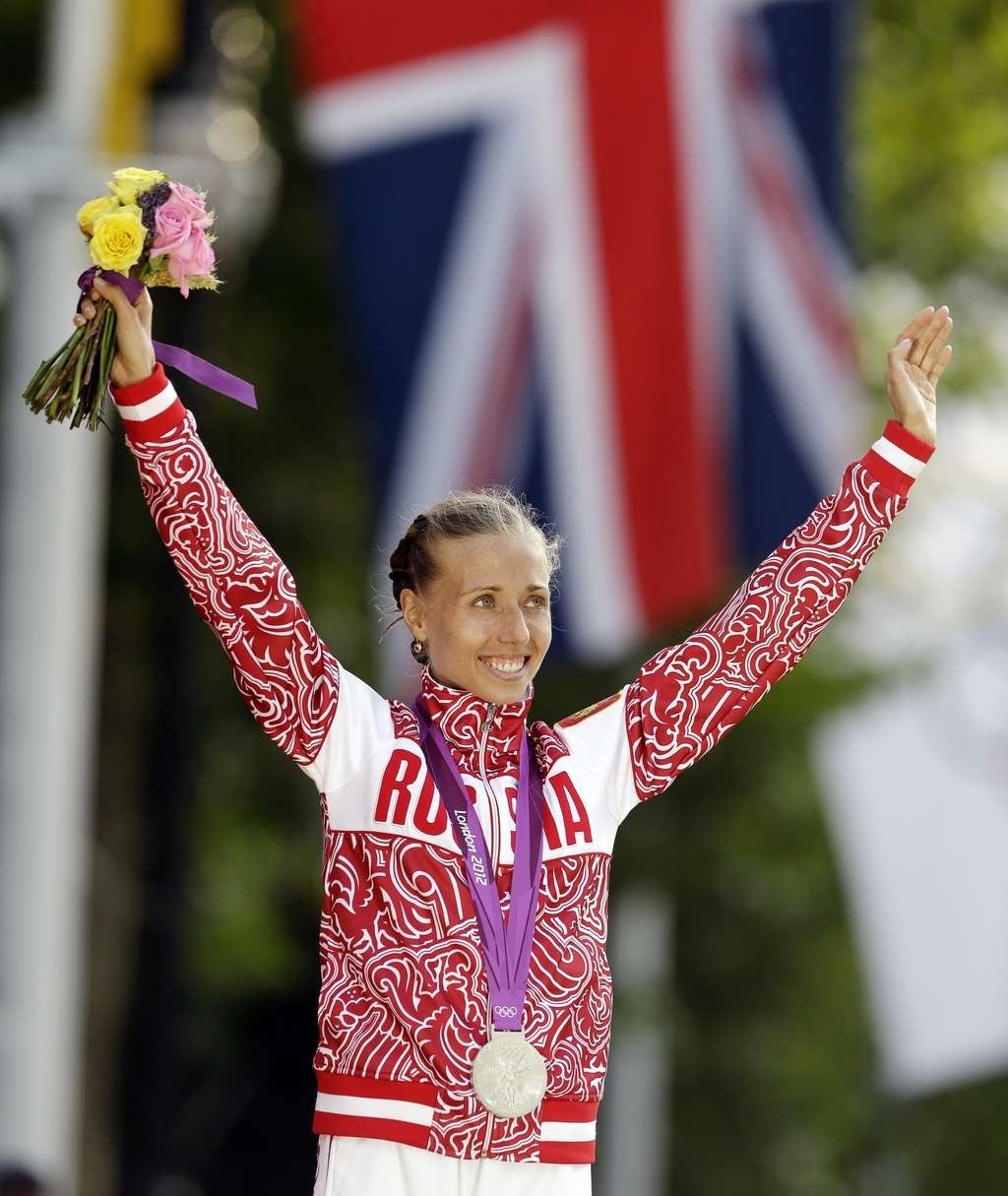 FILE - In this Saturday, Aug. 11, 2012 file photo, silver medalist Olga Kaniskina of Russia reacts during a ceremony after the women's ...