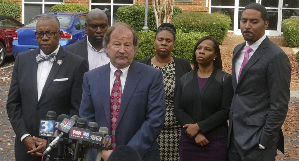 Attorney Charles Monnett speaks during a news conference with the family of Keith Lamont Scott after their meeting with Mecklenburg Cou...