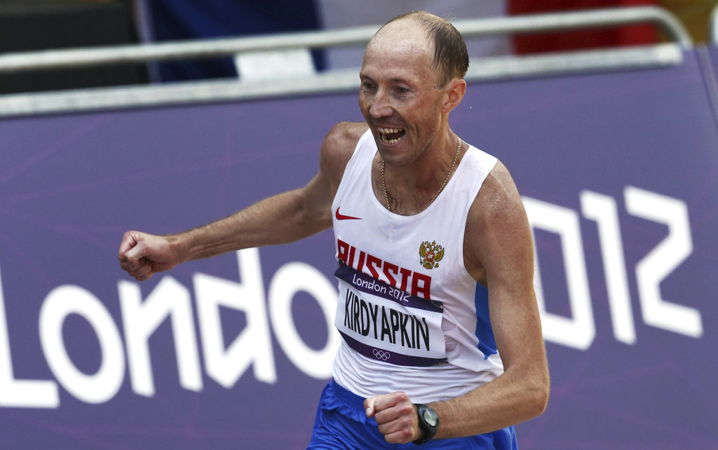 FILE - In this Saturday, Aug. 11, 2012 file photo, Sergey Kirdyapkin, of Russia, wins the gold medal in the men's 50-kilometer race wal...