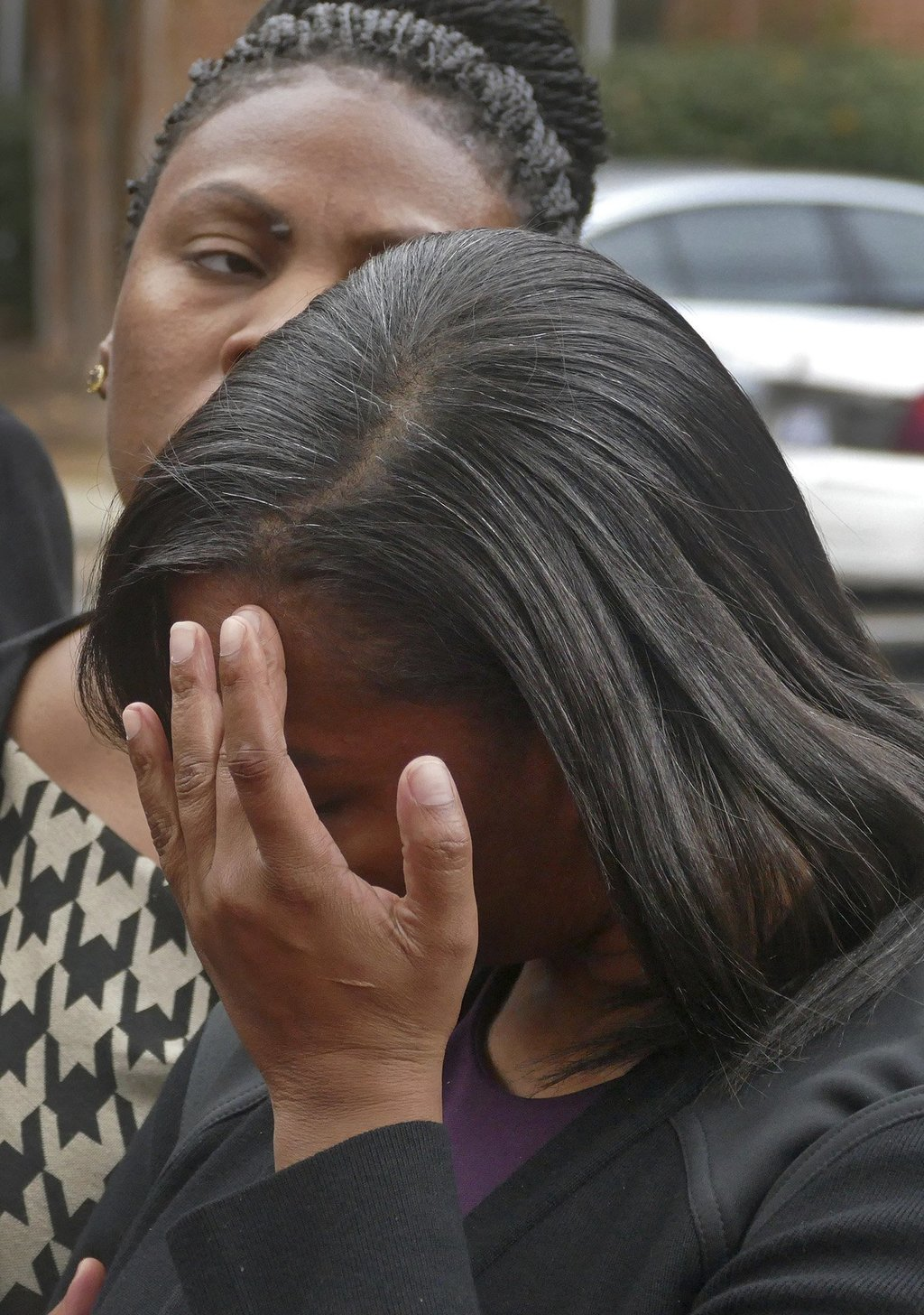Rakeyia Scott, widow of Keith Lamont Scott reacts during a news conference after the family met with Mecklenburg County District Attorn...