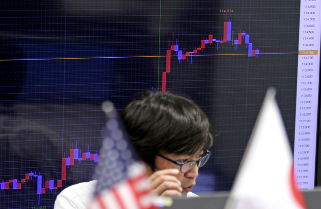 A monitor shows the chart of the current exchange rate between Japanese yen and U.S. dollar, at a foreign exchange brokerage in Tokyo T...