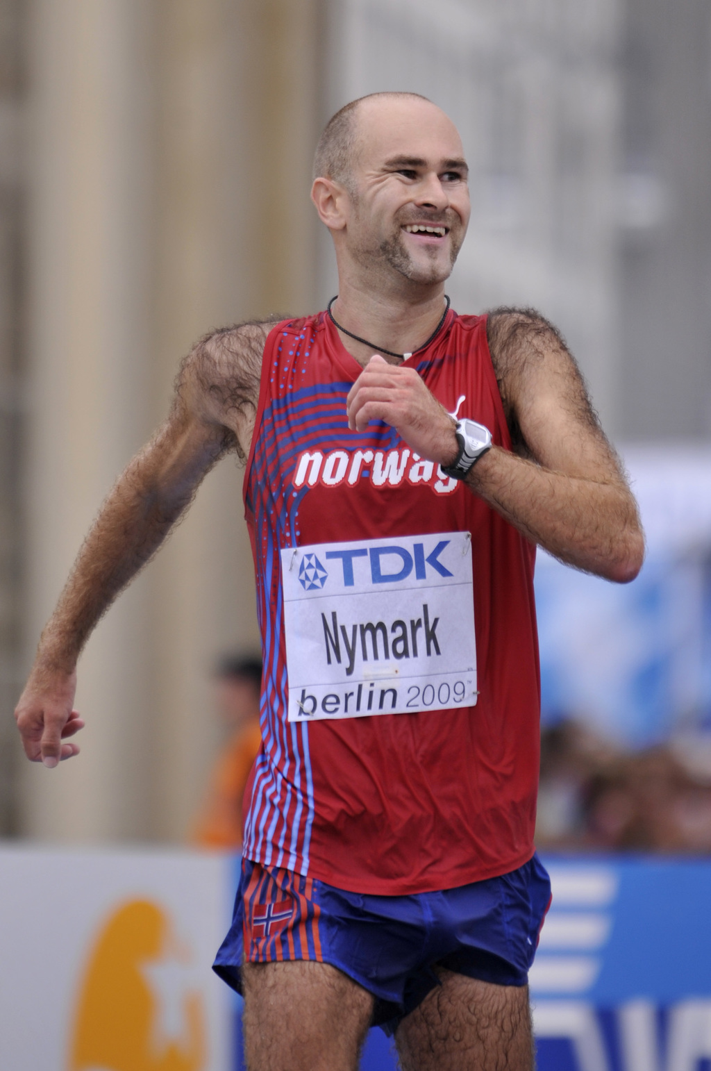 FILE - In this Friday, Aug. 21, 2009 file photo, Norway's Trond Nymark reacts as he crosses the finish line to win silver at the Men's ...