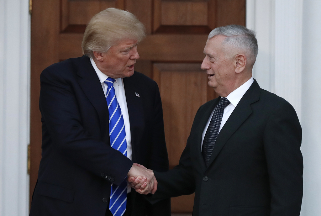 FILE - In this Nov. 19, 2016, file photo, President-elect Donald Trump shakes hands with retired Marine Corps Gen. James Mattis as he l...