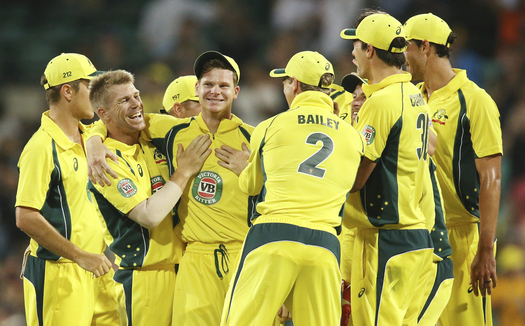 Australian teammates congratulate Steven Smith, third from left, after catching out New Zealand's BJ Watling during their one day inter...
