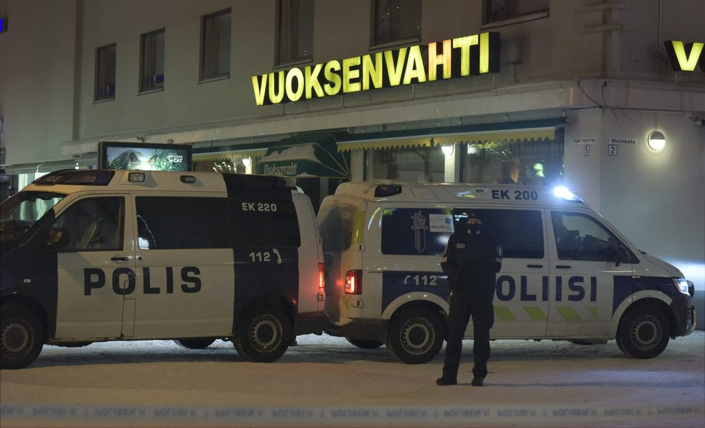 Police guard the area where three women were killed in a shooting incident outside of a restaurant in Imatra, Finland after midnight, S...