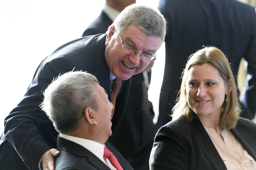 International Olympic Committee, IOC, President Thomas Bach, center, speaks with IOC members Angela Ruggiero, right, of the US and Ser ...