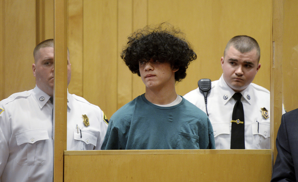 Mathew Borges, 15, center, attends his arraignment in Lawrence District Court in Lawrence, Mass, Monday, Dec. 5, 2016. Borges was held ...