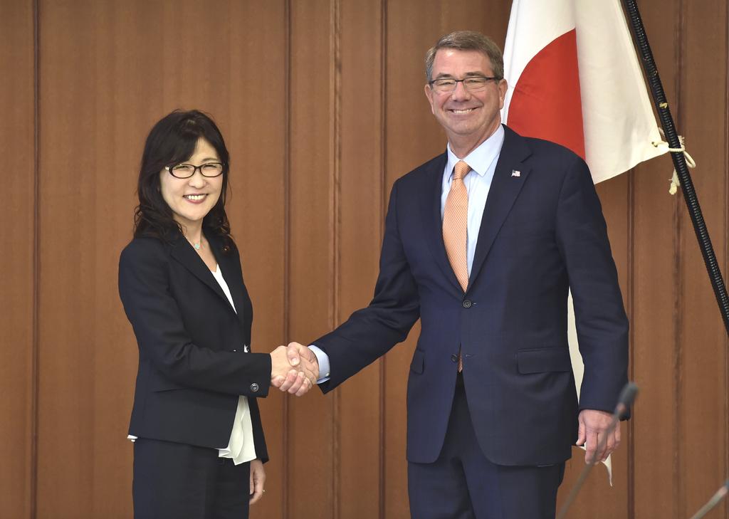 U.S. Secretary of Defense Ash Carter, right, and Japanese Defense Minister Tomomi Inada pose for a photo prior to their meeting at the ...