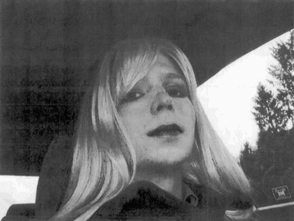 FILE - In this undated file photo provided by the U.S. Army, Pfc. Chelsea Manning poses for a photo wearing a wig and lipstick. A milit...