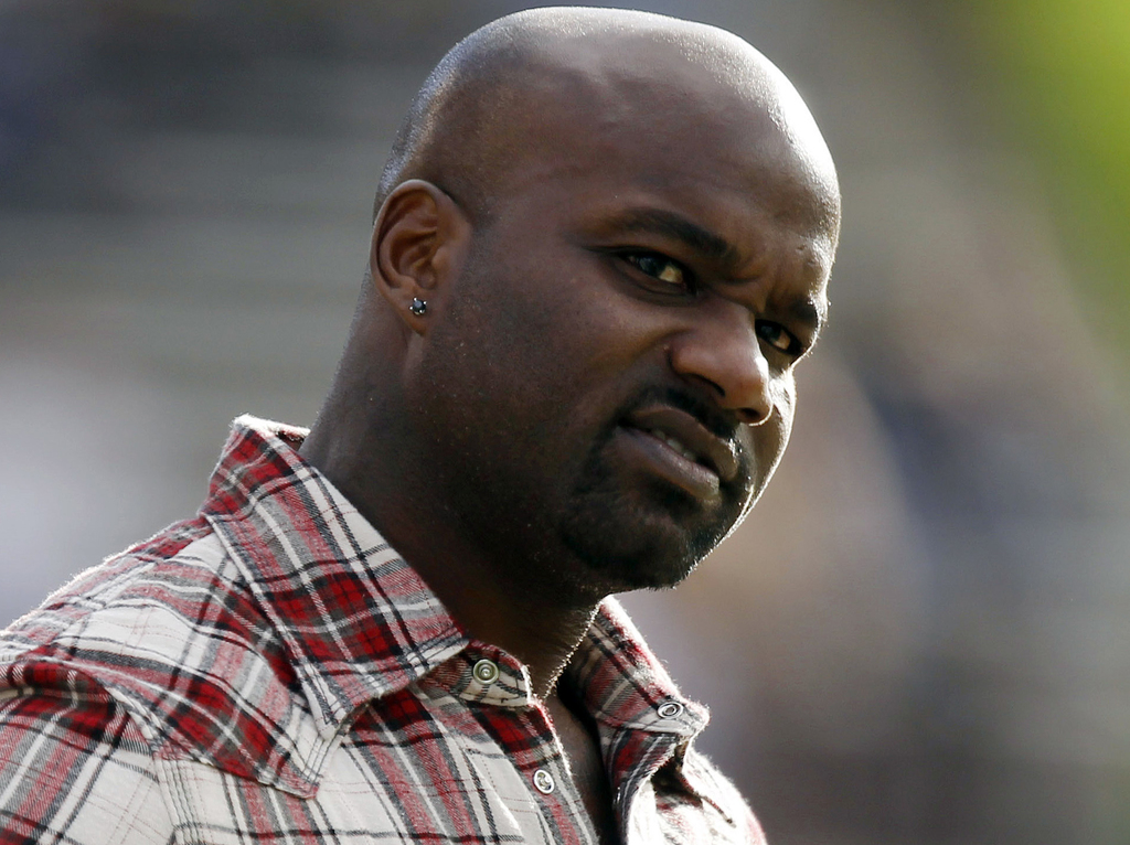 FILE - In this Nov. 7, 2012, file photo, former Colorado running back and Heisman Trophy winner Rashaan Salaam watches from the sidelin...