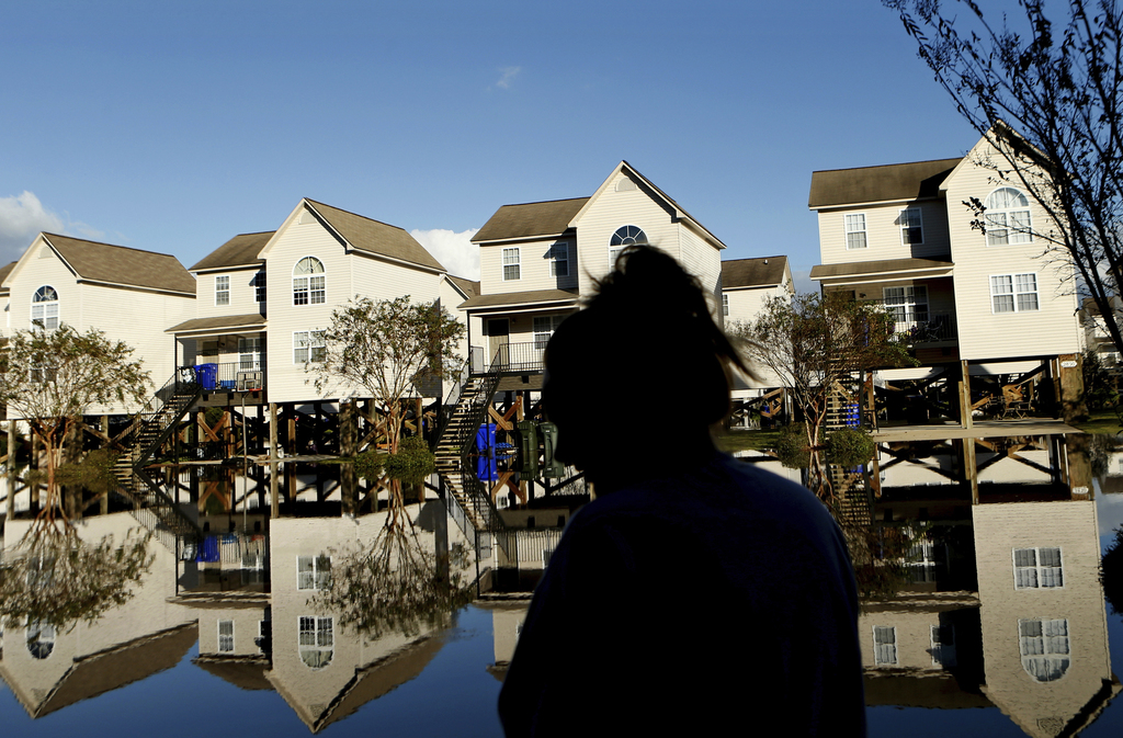 FILE - This Wednesday, Oct. 12, 2016, file photo, shows a neighborhood flooded by water associated with Hurricane Matthew, in Greenvill...