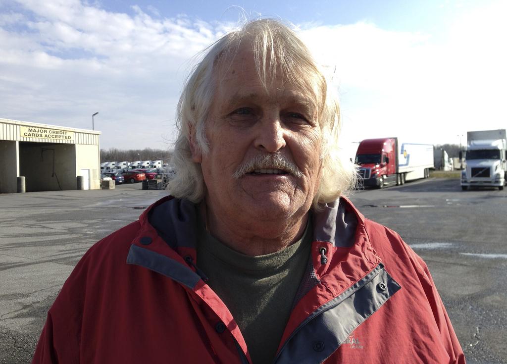 Truck driver Bill Varnado of Dallas, Ga., talks at a truck stop along Interstate 81 in Hagerstown, Md., on Wednesday, Dec. 7, 2016. He ...