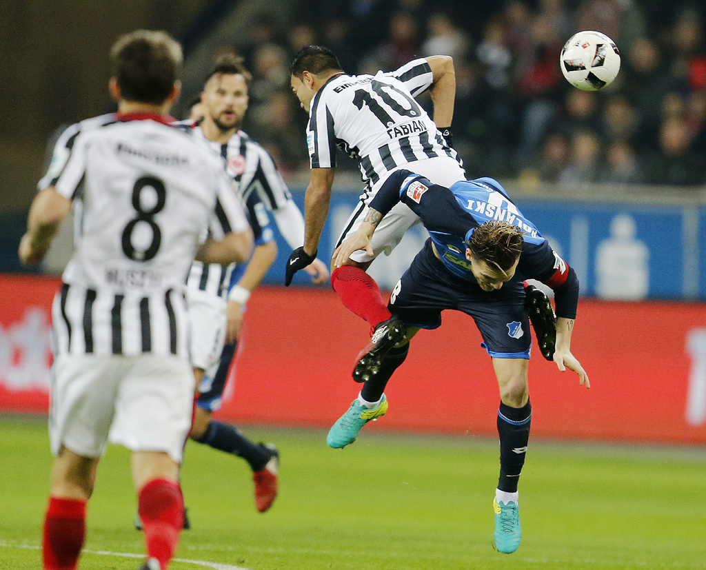 Frankfurt's Marco Fabian, left, and Hoffenheim's Eugen Polanski challenge for the ball during a German first division Bundesliga match ...