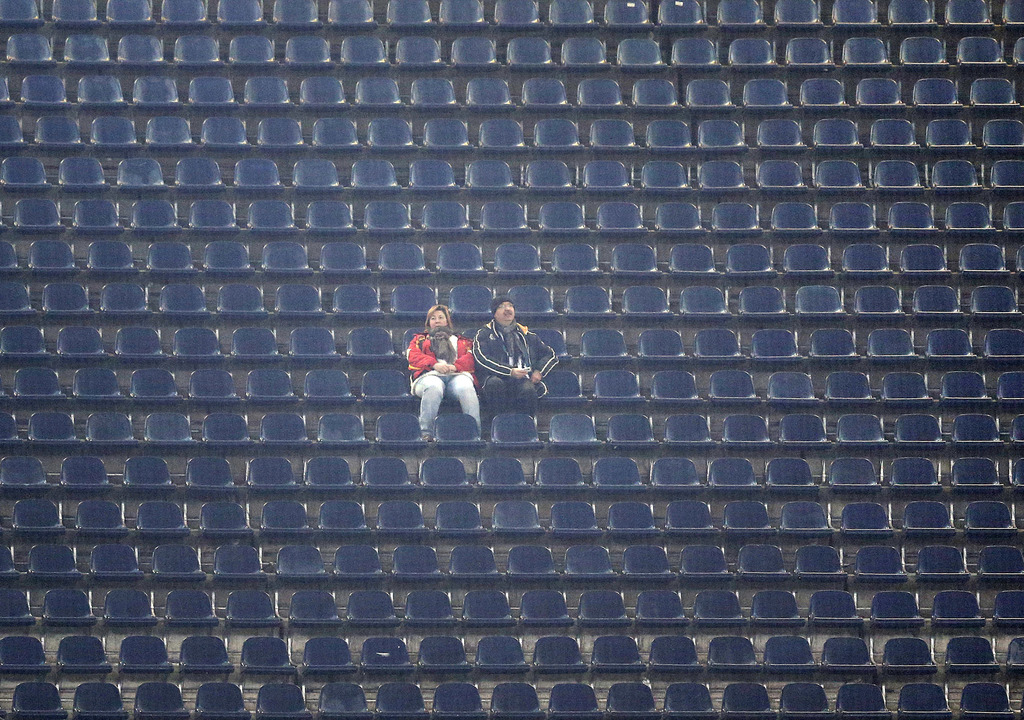 Two Eintracht supporters wait for the beginning of a German first division Bundesliga match between Eintracht Frankfurt and TSG 1899 Ho...