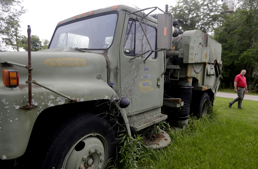 FILE - In this June 16, 2013 file photo, Morven Police Chief Lynwood Yates walks past a military surplus truck in Morven, Ga. National ...