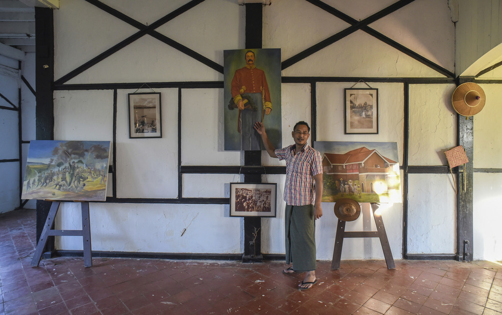 In this Nov. 14, 2016 photo, amateur George Orwell scholar Nyo Ko Naing points to a portrait of a former British colonial official insi