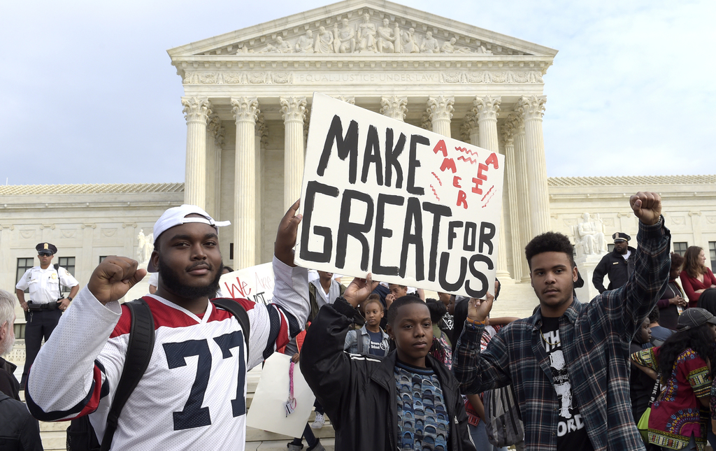 FILE - In this Tuesday, Nov. 15, 2016 file photo, high school students protest outside the Supreme Court building in Washington. Hundre...
