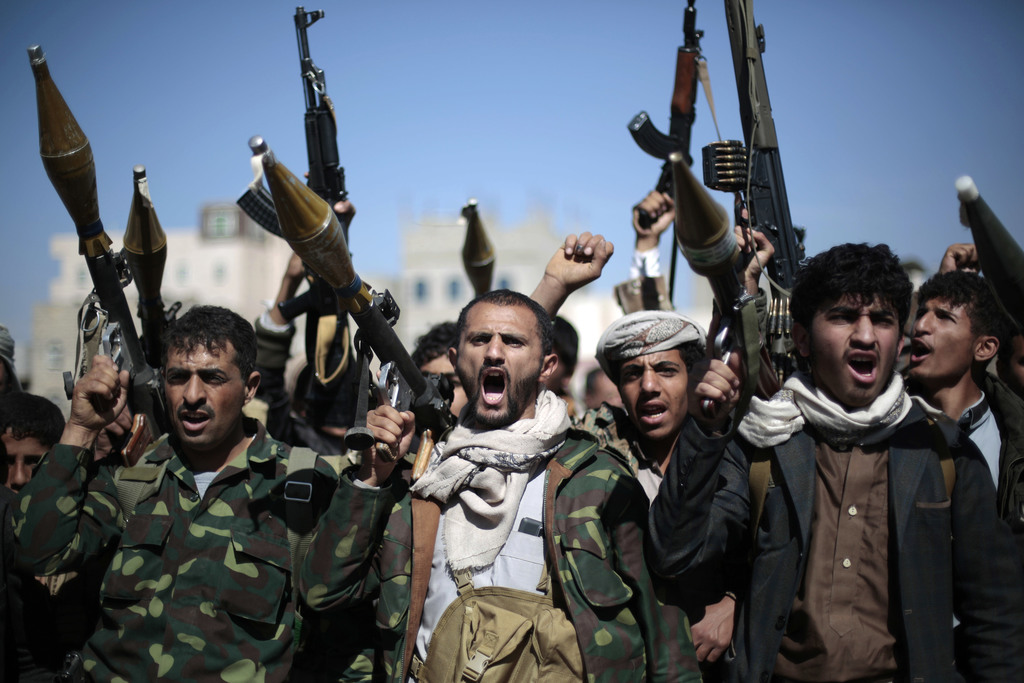 FILE - In this Thursday, Nov. 24, 2016 file photo, tribesmen loyal to Houthi rebels hold their weapons as they chant slogans during a g...